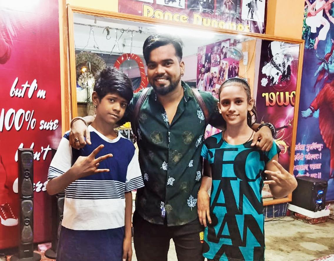 Mohammad Azajuddin and Jashika Khan with their dance trainer Shekhar Rao