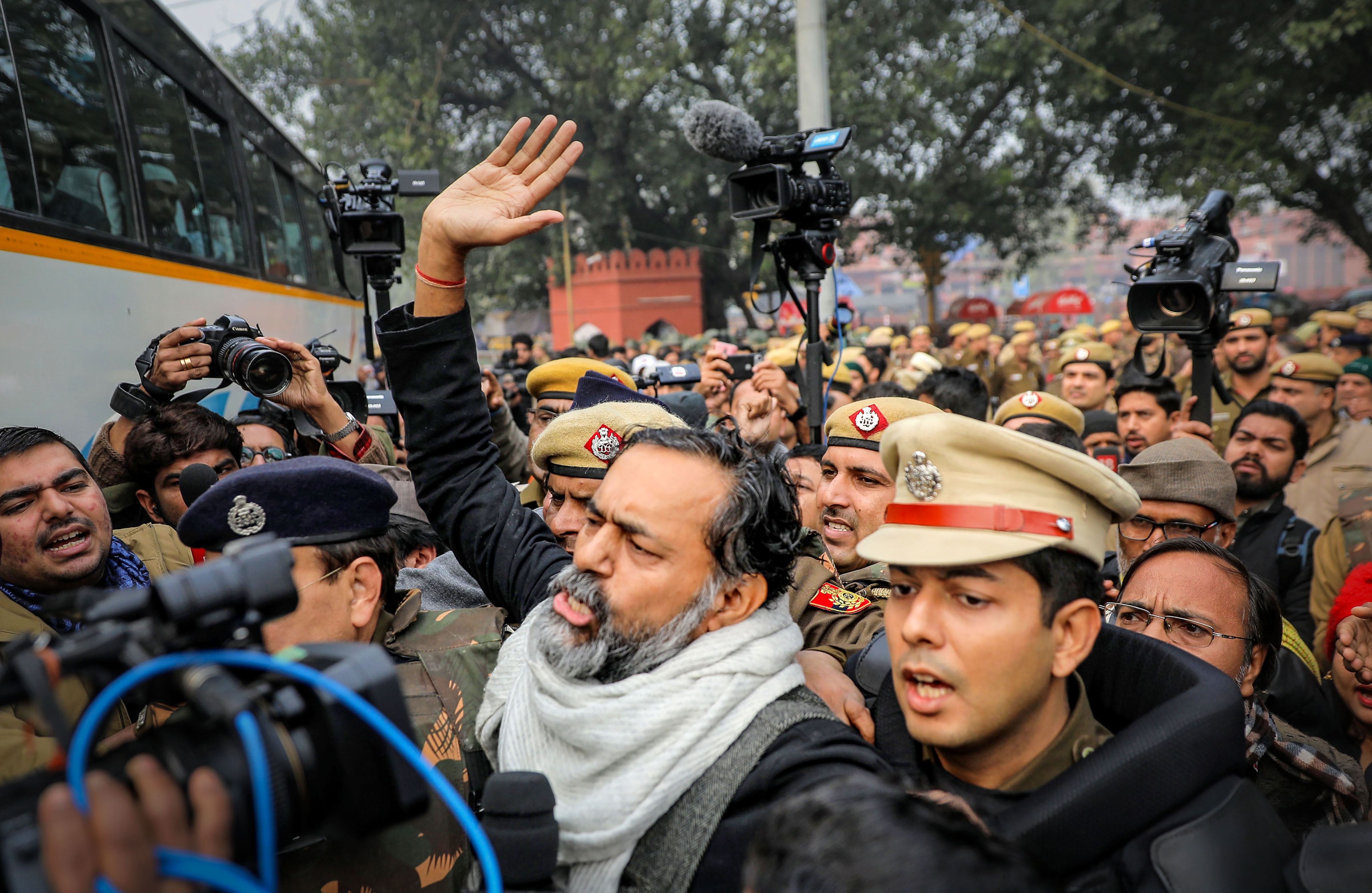 Swaraj Abhiyan founder and activist Yogendra Yadav is detained by police for defying prohibitory orders imposed by the Delhi police in the area during an anti-Citizenship Act protest, at Red Fort, in New Delhi, Thursday, December 19, 2019.