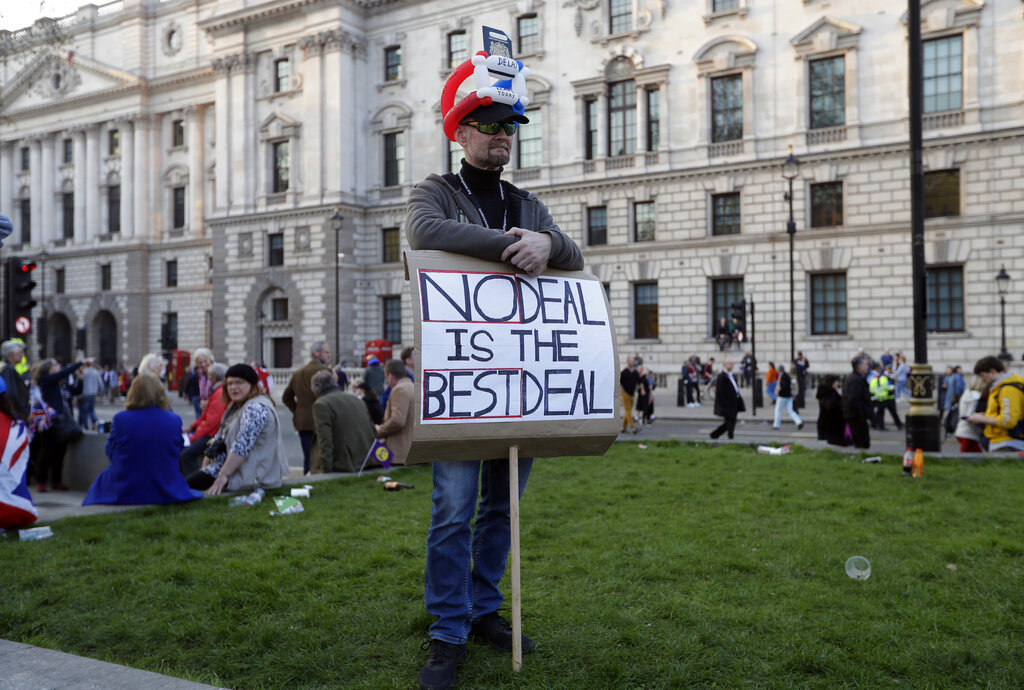 A Brexit supporter holds a sign during a rally after the final leg of the