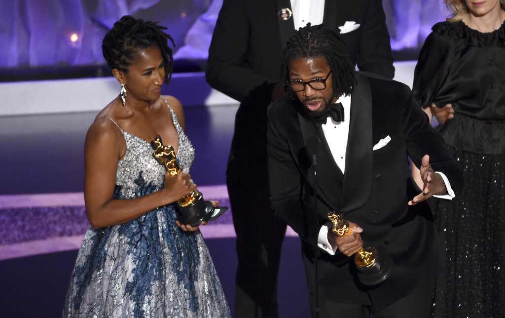 Karen Rupert Toliver, left, and Matthew A. Cherry accept the award for best animated short film for
