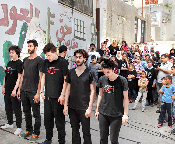 The street play 'Return to Palestine' performed by third-year students of The Freedom Theatre School