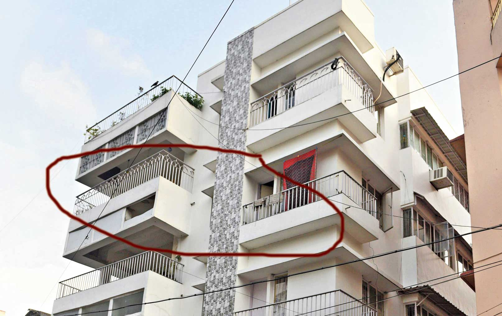 The apartment (circled) in Jodhpur Park where the 75-year-old woman was found dead.