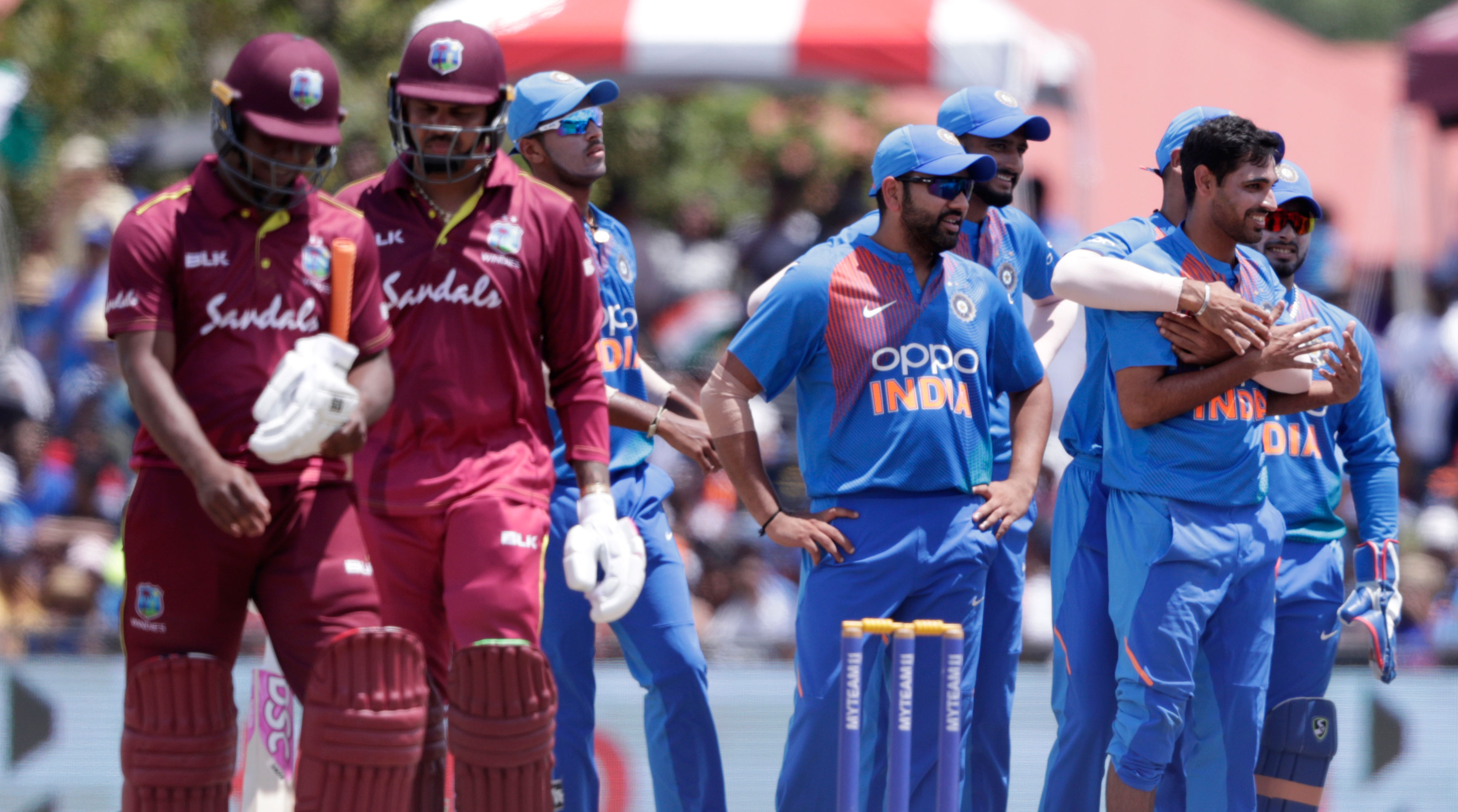 Bhuvneshwar Kumar is congratulated after taking the wicket of West Indies' Evin Lewis during their second Twenty20 international cricket match on August 4, 2019.