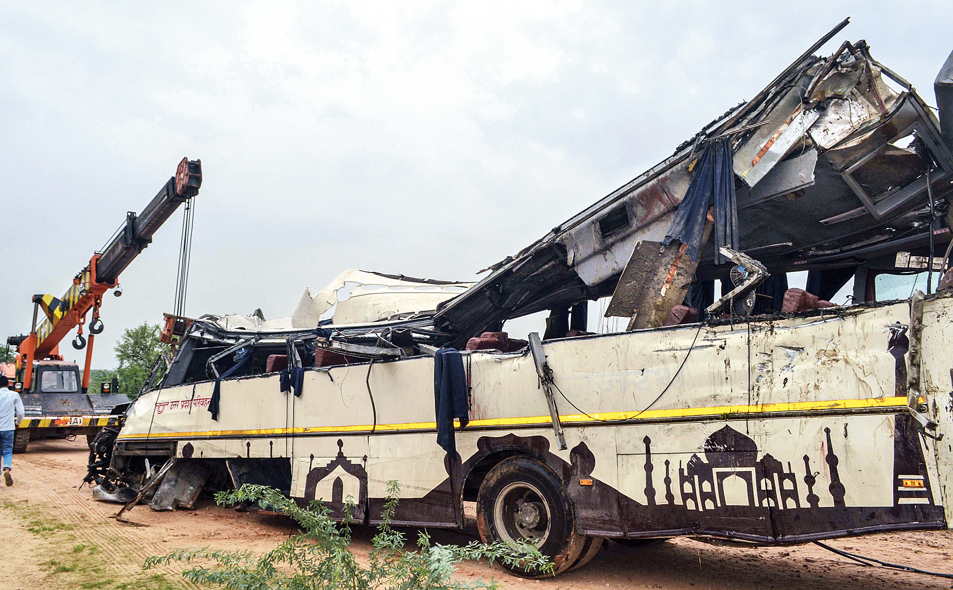 Mangled remains of the bus after it skidded off the Yamuna Expressway on Monday.