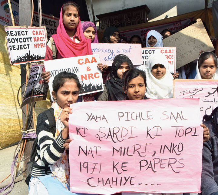 Touch of Humour: Protesters at Ara Mor in Wasseypur, Dhanbad, on Monday.