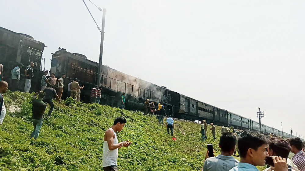 Smoke billows out of the engine at Chaterhat, near Siliguri, on Friday