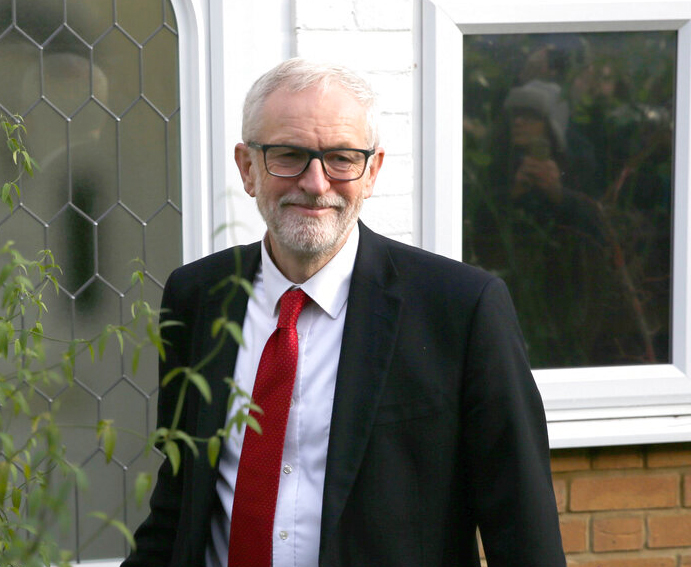 Britain's Labour Party leader Jeremy Corbyn leaves his home in Islington, north London, Friday December 13, 2019, after Prime Minister Boris Johnson led his Conservative Party to a landslide victory in Britain's election that was dominated by Brexit.