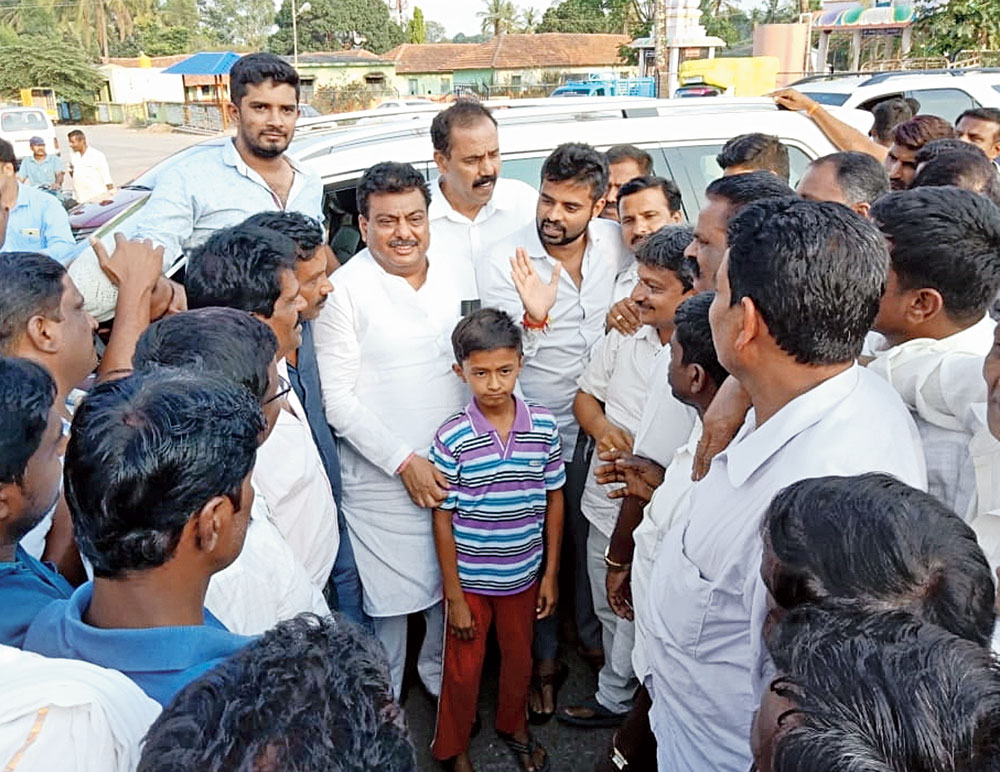 Prajwal Revanna (centre, bearded) interacting with party workers in Hassan. To his right wearing a kurta is Karnataka home minister MB Patil