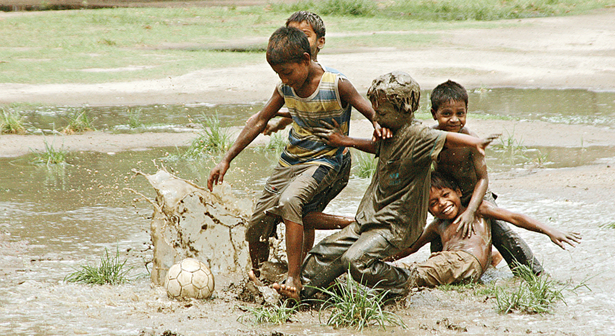Children playing in the rain.