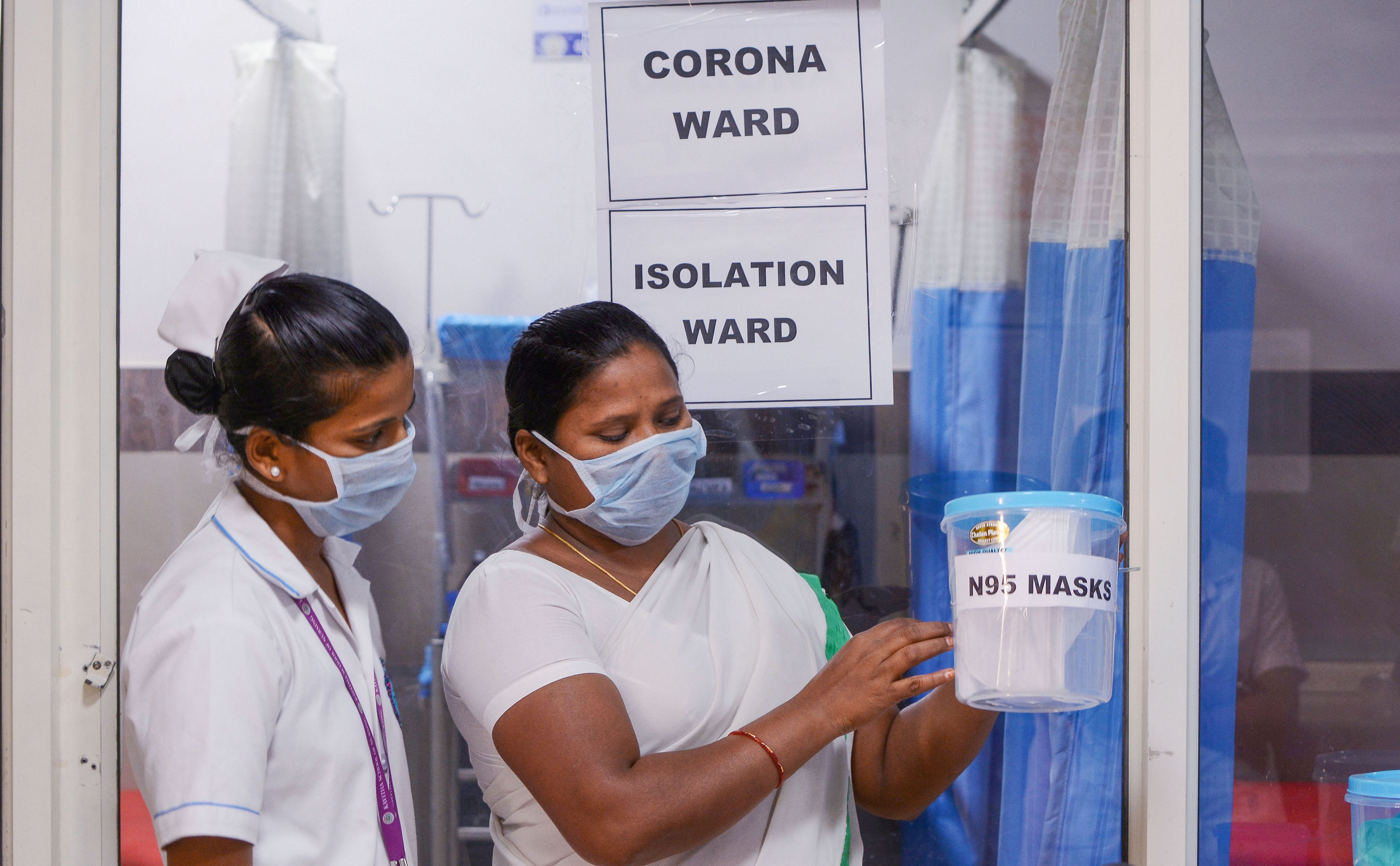 In this file photo taken on Saturday, February 1, 2020, in Vjaywada, nurses look at N95 masks inside a Coronavirus ward at a government hospital. A man flying from Delhi was admitted to an isolation ward of Naidu Hospital in Pune on Friday for possible exposure to novel coronavirus.