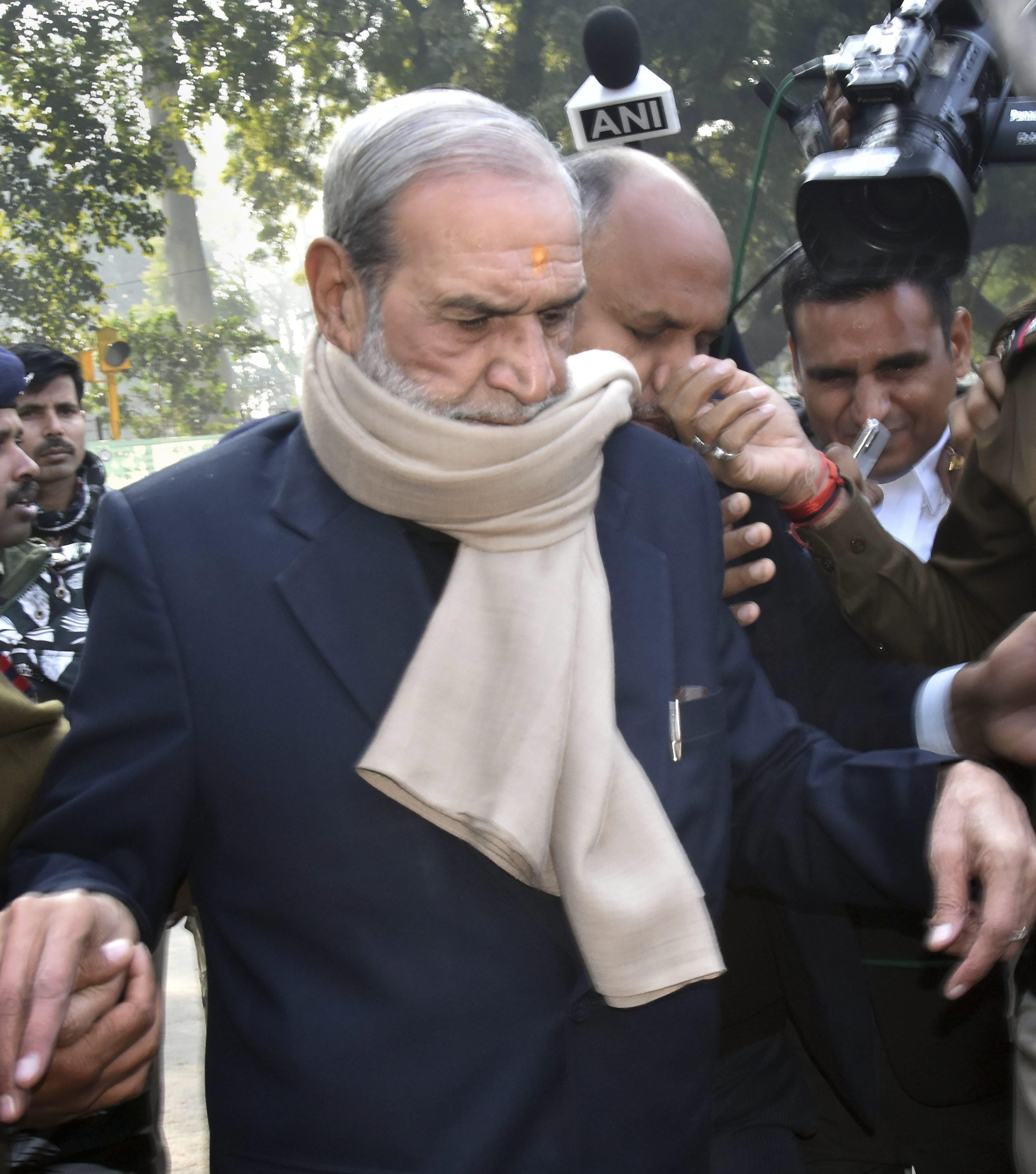 Sajjan Kumar arrives at the Patiala House Court on Thursday.