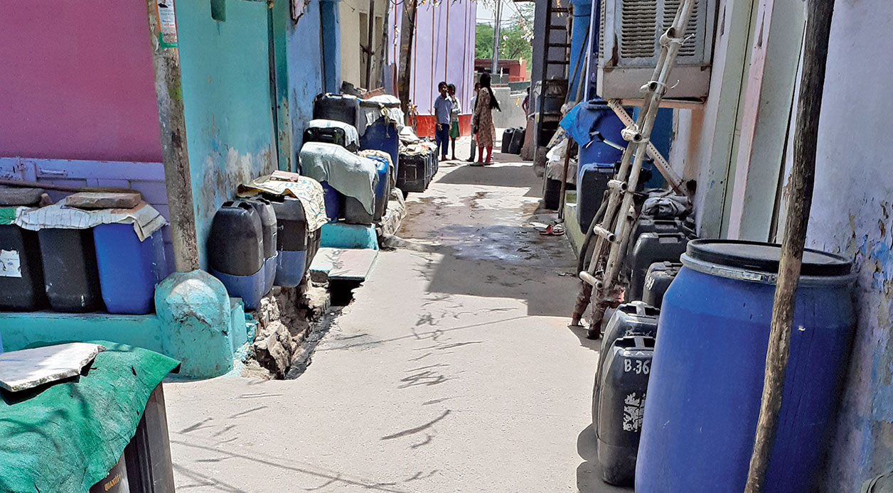 Water cans lined up in Kusumpur Pahari.