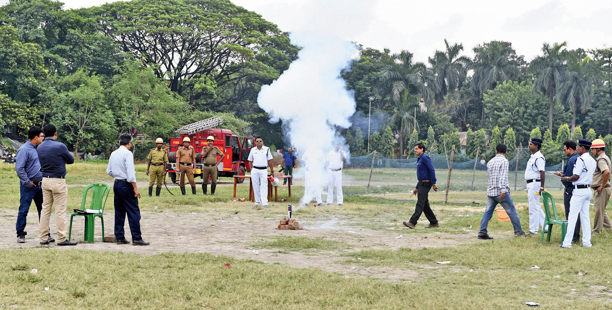 State pollution control board and Petroleum and Explosives Safety Organisation officials, along with police and fire officers and firecracker traders, during the test in Tallah Park on Monday.