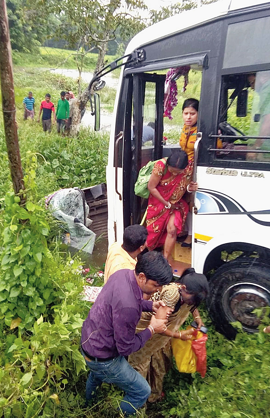 Passengers being rescued from the bus in Demow on Monday.