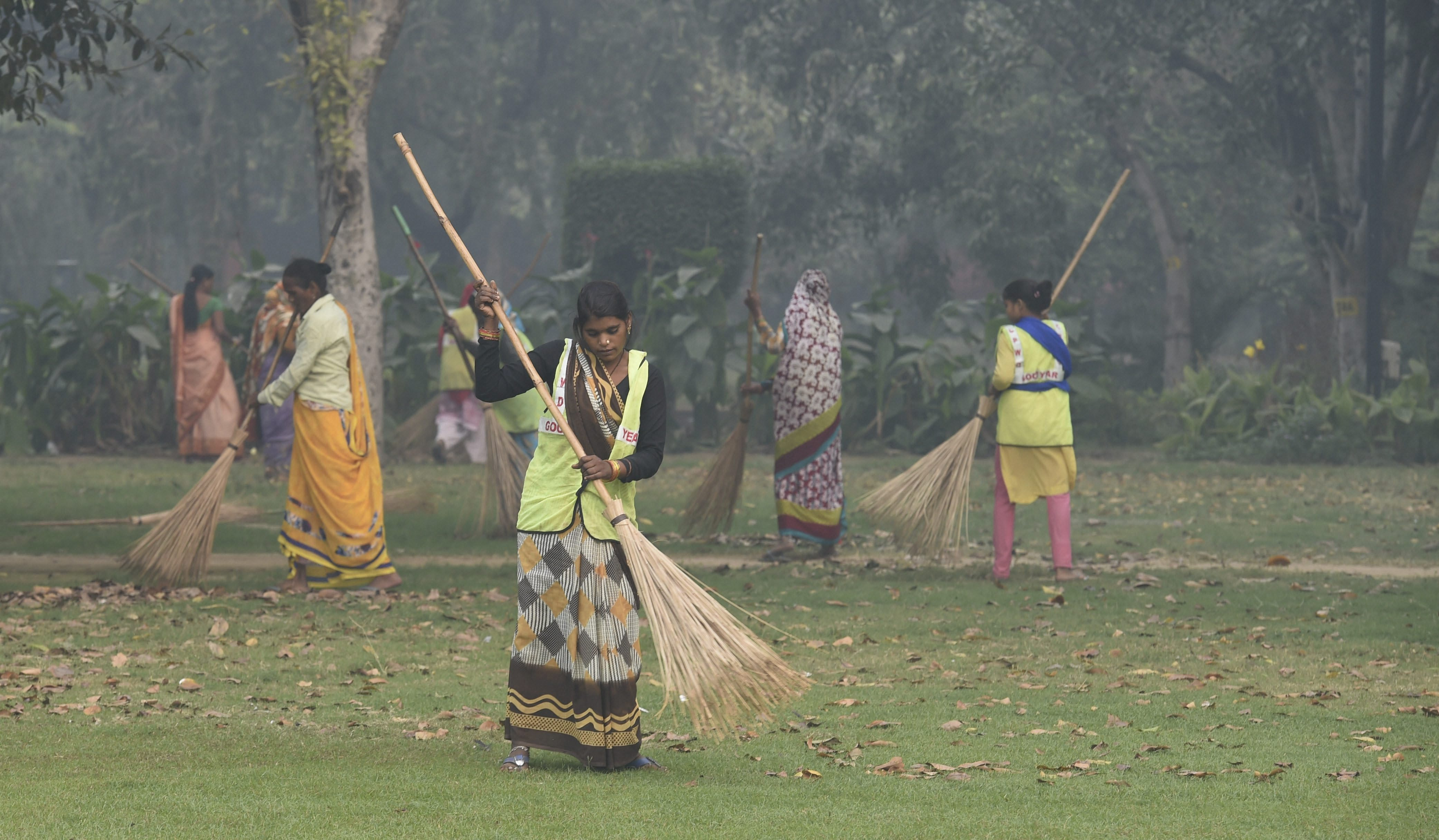 Central Public Works Department workers sweep the grounds at India Gate in Delhi on Monday, November 5, two days before Diwali. Government officials attributed the spike in pollution levels to burning of crop stubble in fields in northern India.