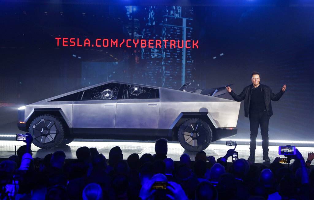 In this Nov. 21, 2019 file photo, Tesla CEO Elon Musk introduces the Cybertruck at Tesla's design studio in Hawthorne, California.