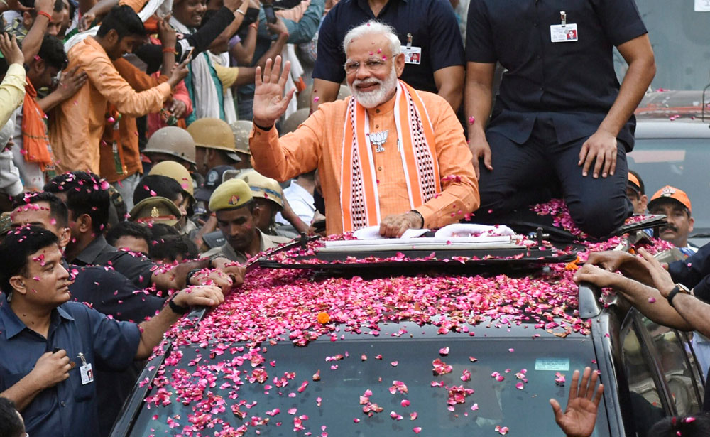 Prime Minister Narendra Modi during the roadshow in Varanasi on Thursday
