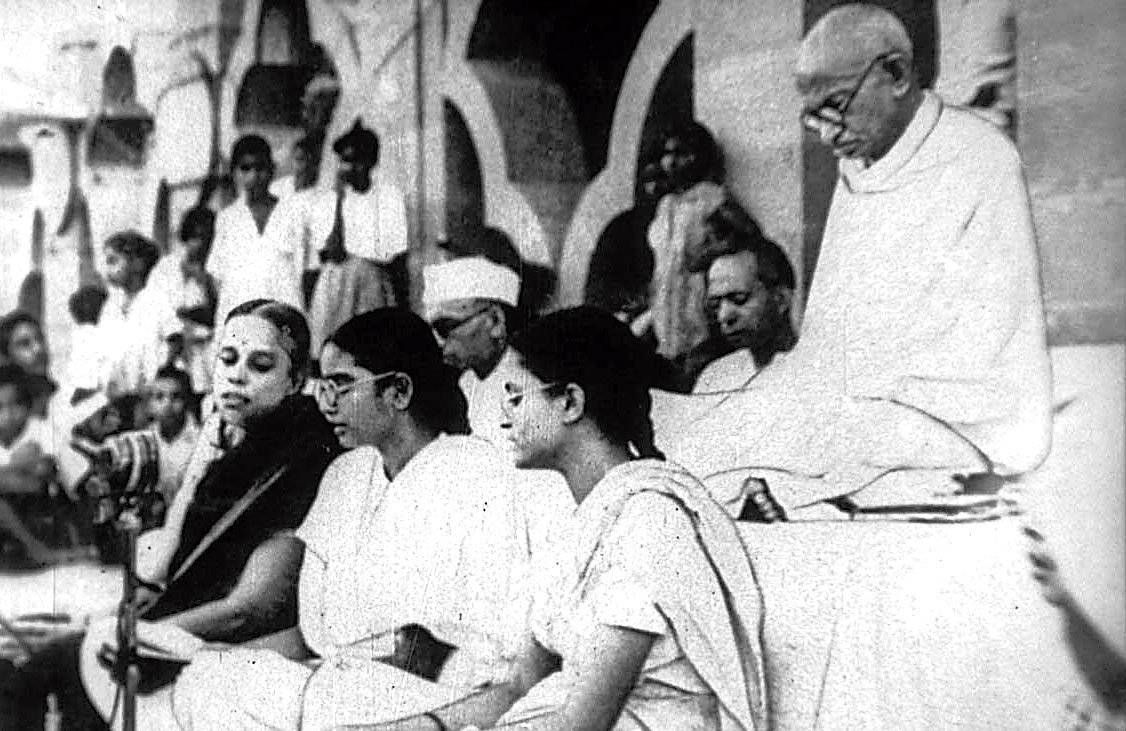 M.K. Gandhi listens to a bhajan at a prayer meeting at Birla House