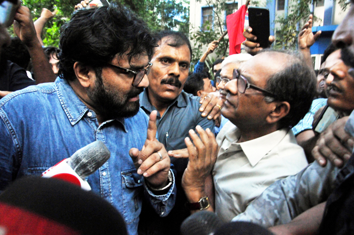 """Footage has emerged showing Babul Supriyo, 48, throwing his weight around """"as the elected representative of the country and minister"""" as Suranjan Das, 65, the Jadavpur University vice-chancellor, politely tries to reason with the BJP leader in the middle of Thursday's standoff."""