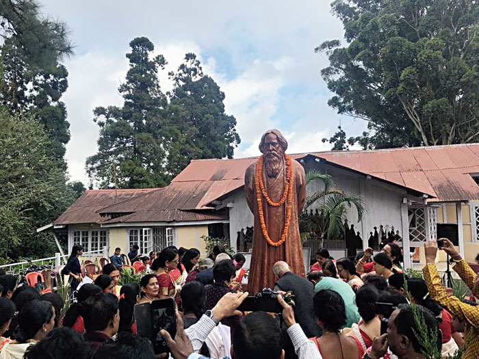 Residents of Shillong flock to Brookside on Friday morning. One hundred lamps were lit and a 100 conches blown to mark the centenary of Rabindranath Tagore's first visit to Shillong and stay at this cottage in October 1919