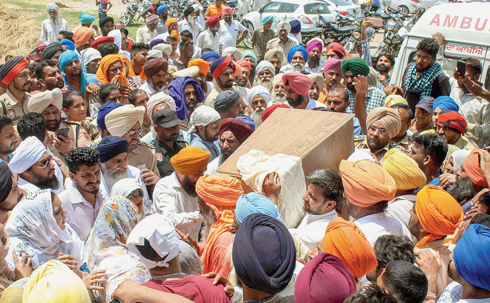 Relatives carry the coffin of Fatehveer for his last rites at their village in Sangrur district, Punjab, on Tuesday