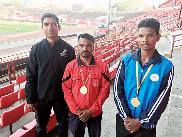 Ashok Soren (centre) and Deepak Kisku (right) with mentor Ranjit Gope at JRD Tata Sports Complex on Friday.