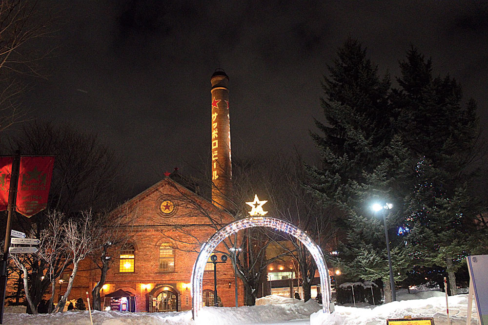 The famed red-brick Sapporo Beer Museum is lit up during the winter months