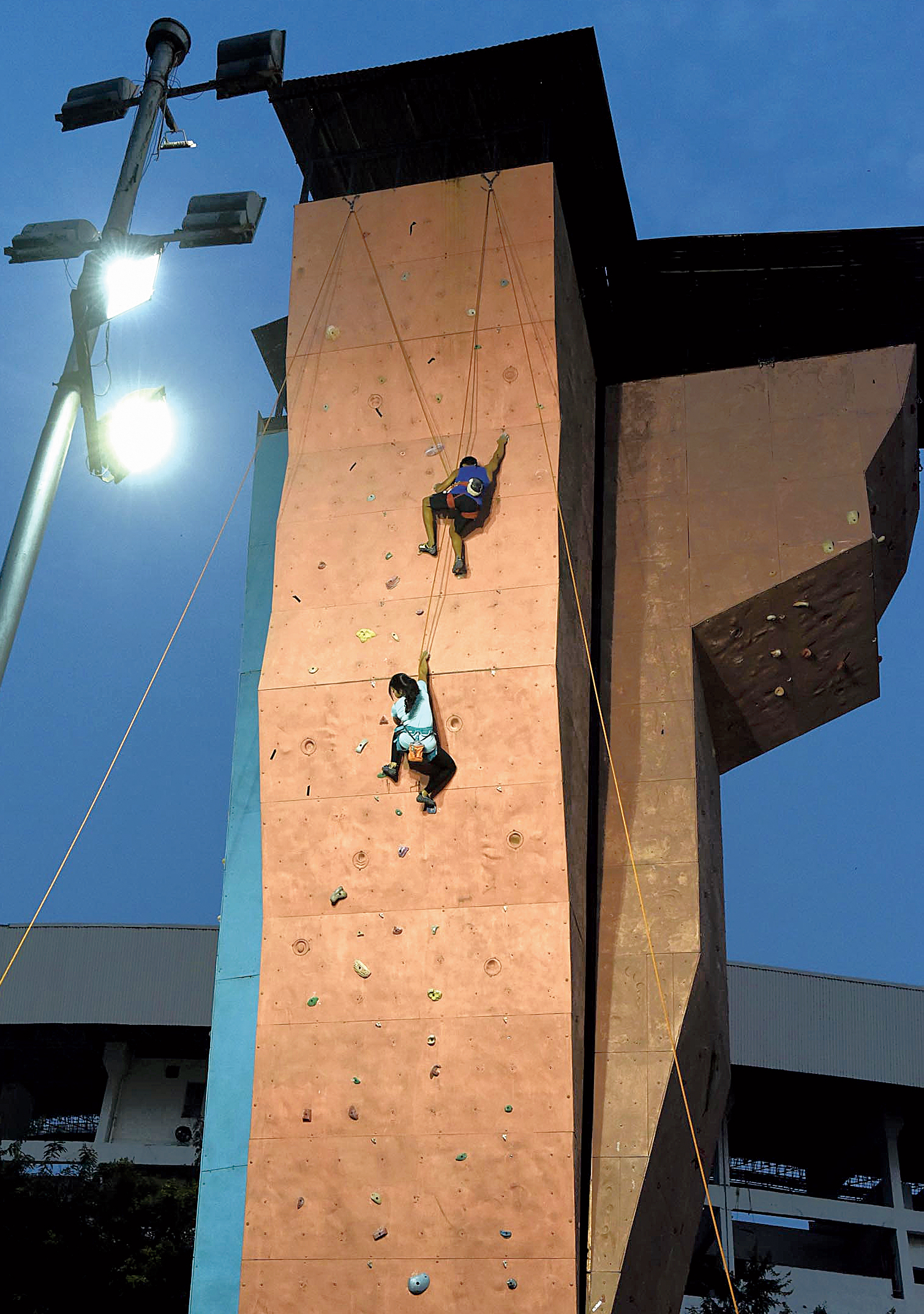 Anwesha Konar and Suraj Singh practise at Salt Lake stadium's sport climbing wall.