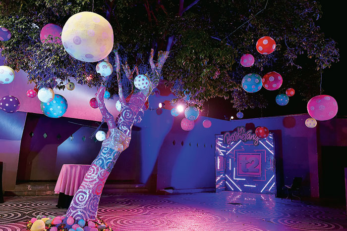 This zone was a continuation of the neon mood with the tree wrapped in printed neon sheets with hand-painted giant foam balls hanging from the branches.