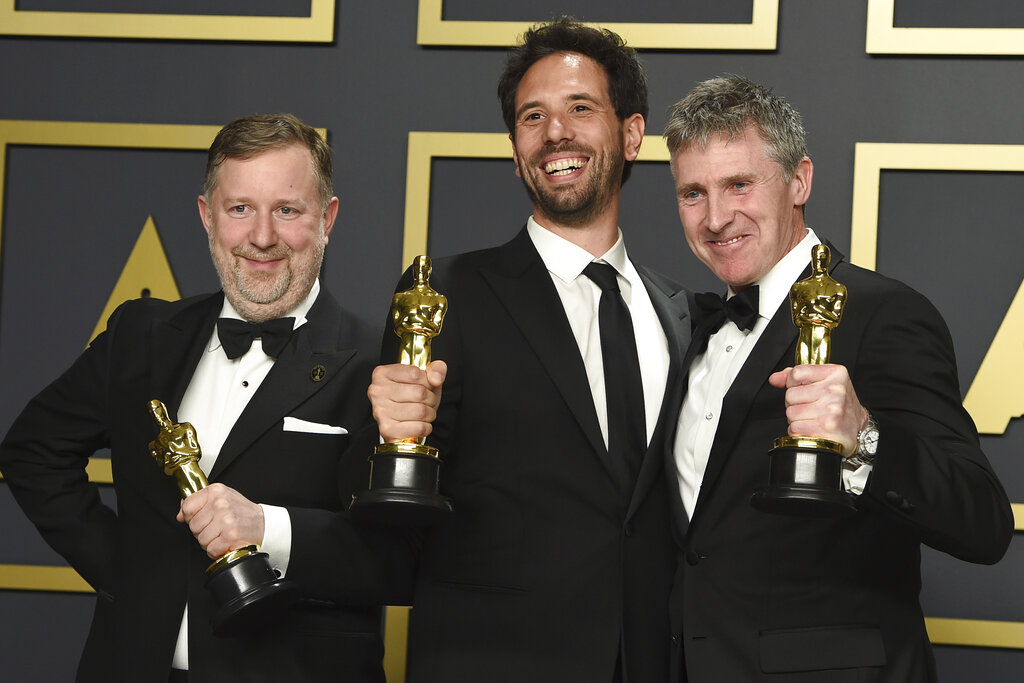 Greg Butler, from left, Guillaume Rocheron, and Dominic Tuohy, winners of the award for best visual effects for