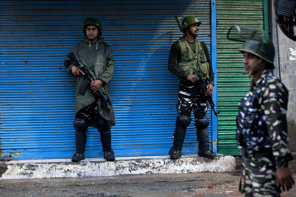 Indian paramilitary soldiers stand guard in Srinagar on August 14.