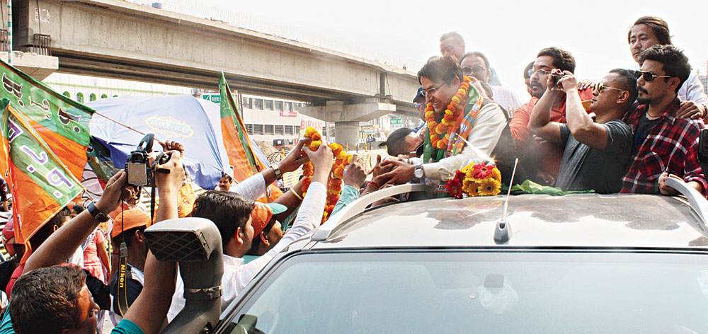 Raju Bista being garlanded outside the Bagdogra airport on Monday.