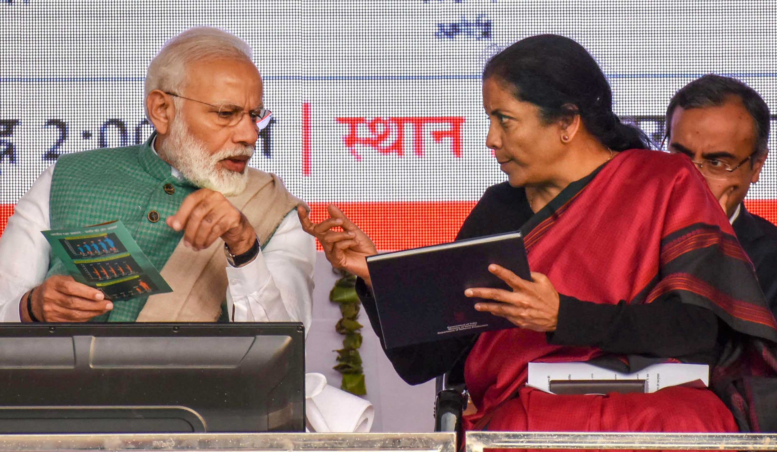 Narendra Modi with defence minister Nirmala Sitharaman during a public rally to launch a Kalashnikov rifles manufacturing facility in Amethi on Sunday.