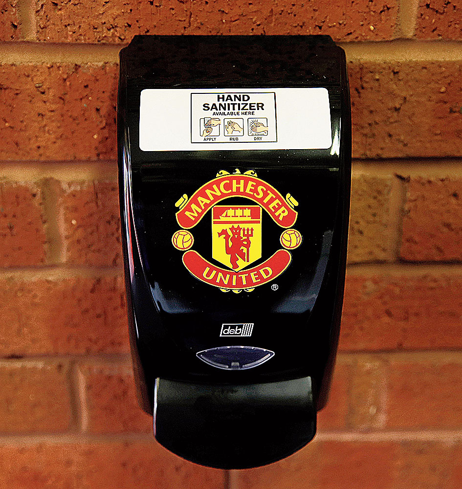 A hand sanitizer dispenser is seen outside Old Trafford, on Sunday.