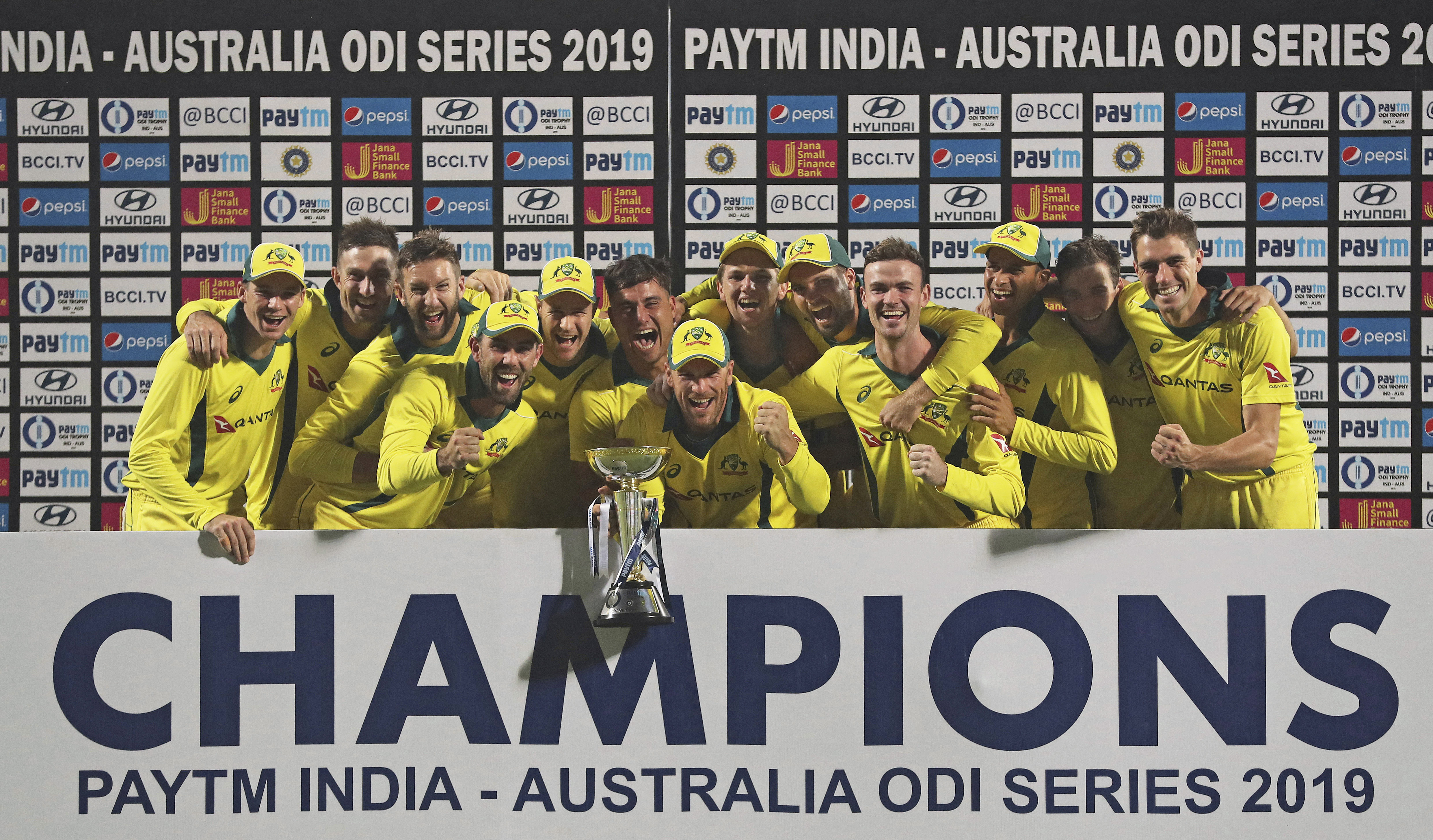 Australia cricketers pose with the trophy after defeating India in the fifth and final one-dayer, at the Kotla, to clinch the series 3-2.