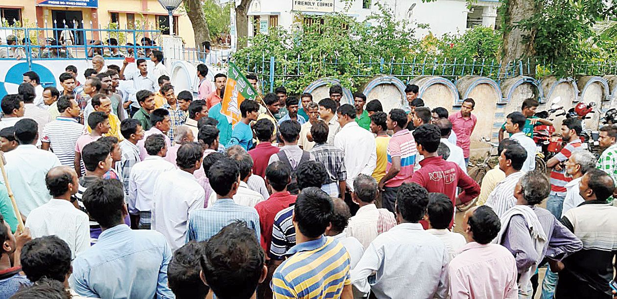BJP workers agitate in front of Labhpur police station on Friday.