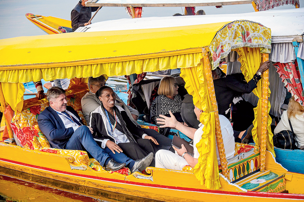 Members of the European Parliament take a shikara ride in the Dal Lake in Srinagar on Tuesday. Officials had stopped traffic on the road and chosen a desolate patch of the lake to prevent any interaction between the MEPs and ordinary citizens