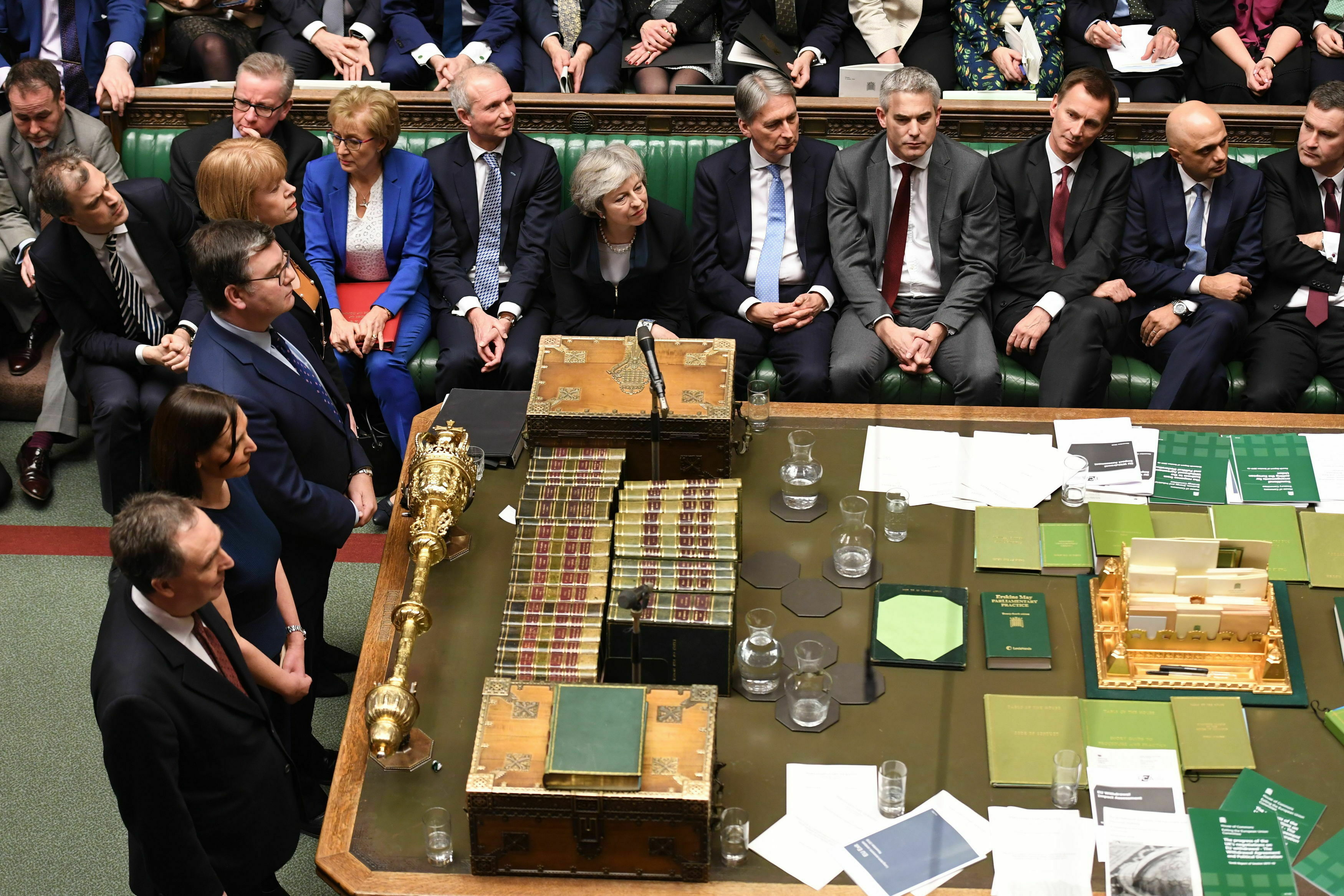 In this image issued by the House of Commons of British Prime Minister Theresa May looks on as MPs announce that she has lost a vote on her Brexit plan.