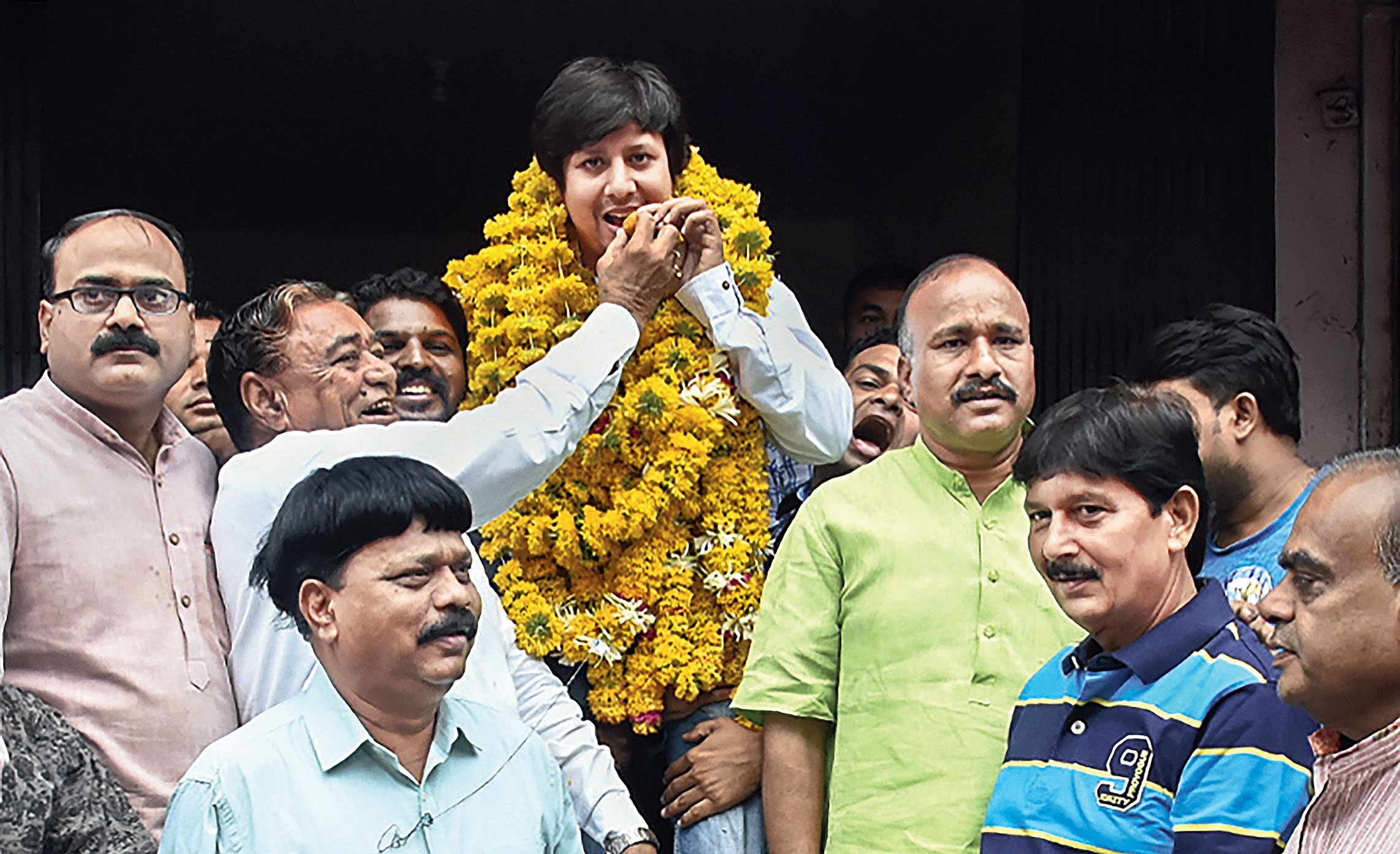 Akash being offered sweets after his release in Indore on Sunday.