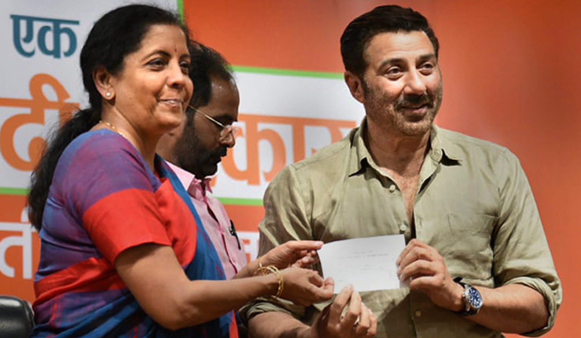 Nirmala Sitharaman inducts actor Sunny Deol into the BJP at the party's headquarters in New Delhi on Tuesday, April 23, 2019