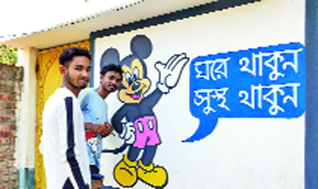 Animesh (right) and a friend spread awareness through Mickey Mouse