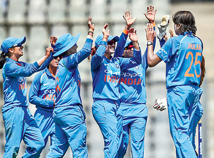 India's Jhulan Goswami celebrates with the teammates after the dismissal of England's Tammy Beaumont during the third ODI in Mumbai on Thursday