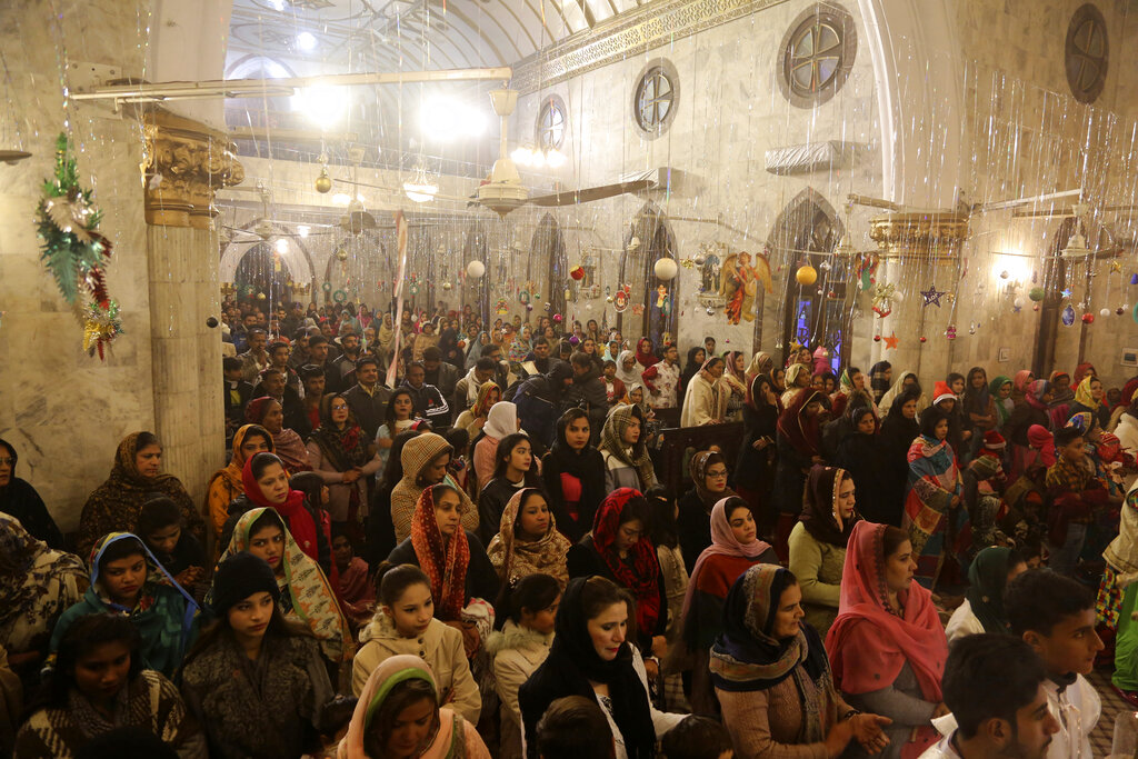 Pakistani Christians attend midnight services at St. Anthony's Church to celebrate Christmas in Lahore, Pakistan, Tuesday, Dec. 24, 2019.