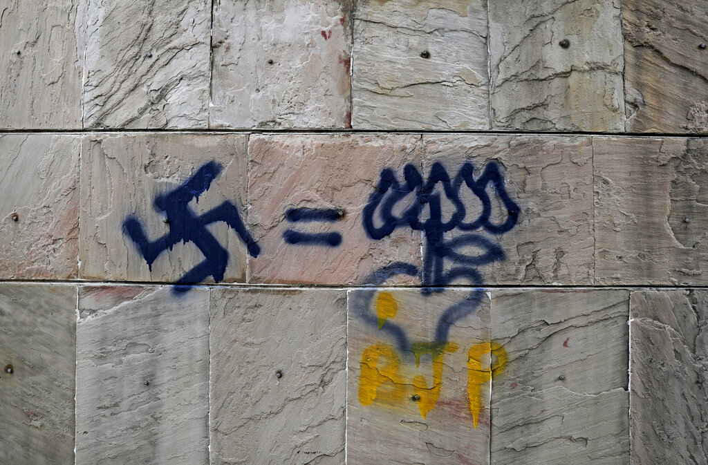 Graffiti in Jamia Millia Islamia that equates Nazi's Swastika with Lotus (BJP's election symbol), spray-painted in the university