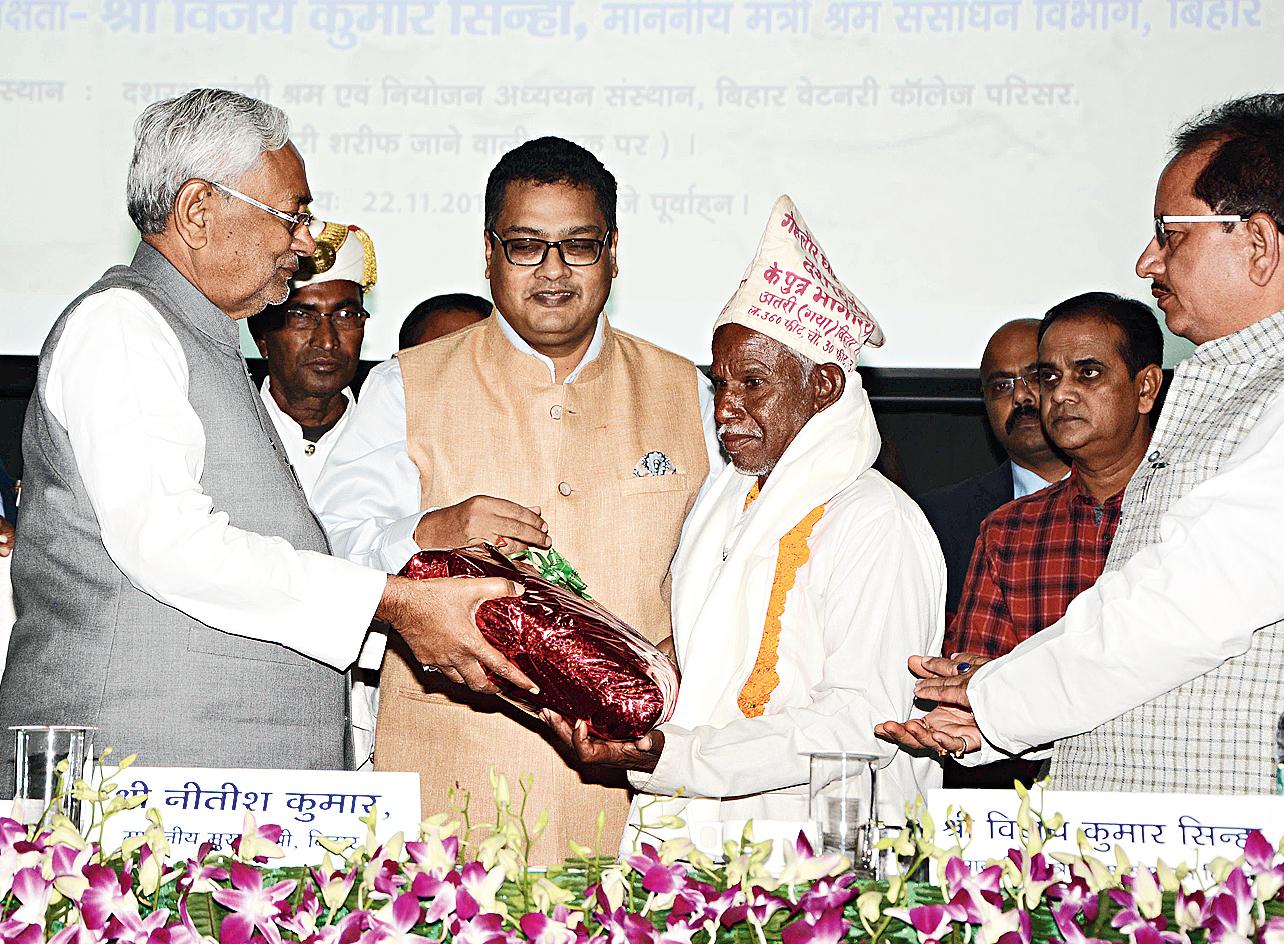 "Chief minister Nitish Kumar felicitates Bhagirath Manjhi, the son of ""Mountain Man"" Dashrath Manjhi, during the inauguration of the newly built Dashrath Manjhi Labour & Empowerment Studies Institute near the Veterinary College in Patna on Thursday."