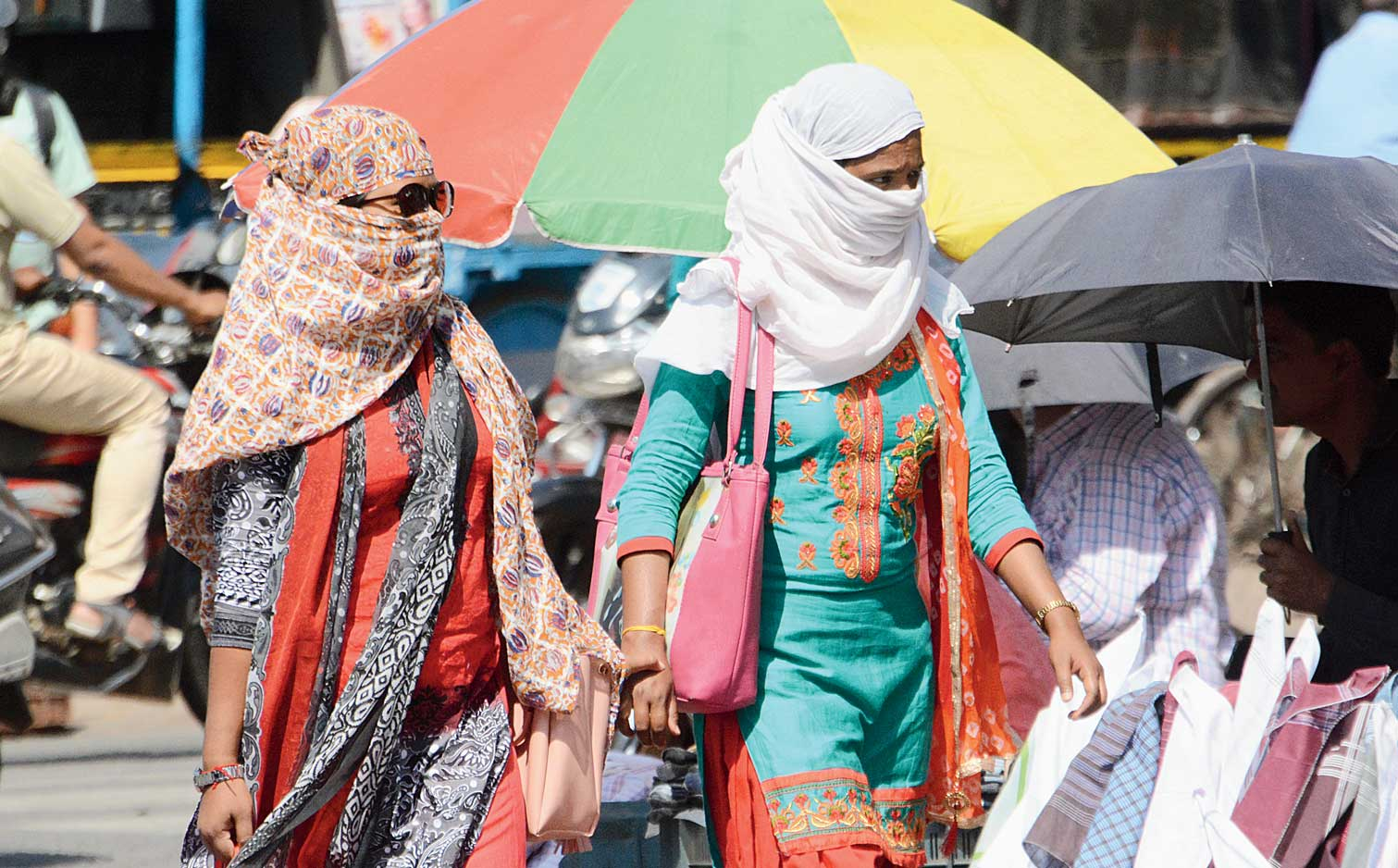 Girls take sun cover in Sakchi, Jamshedpur, on a sunny Sunday afternoon.