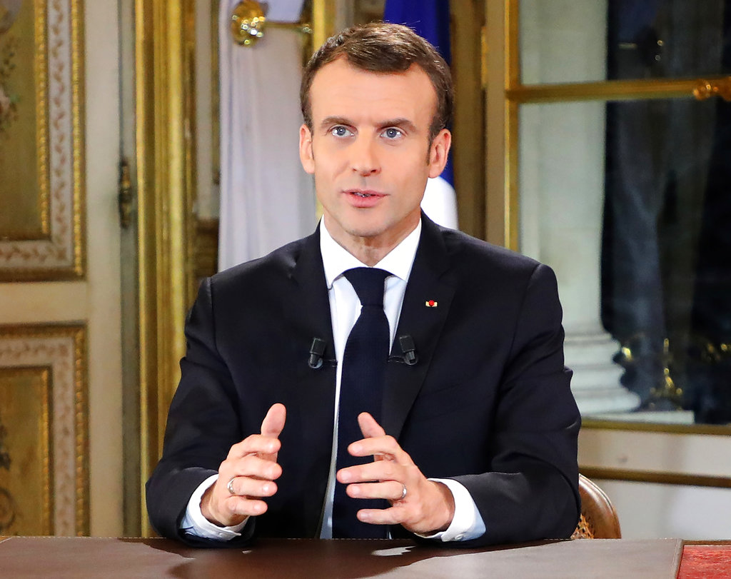 Macron offers concessions and scales back focus on Europe