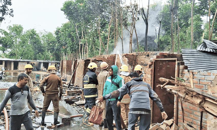 Firefighters douse the blaze