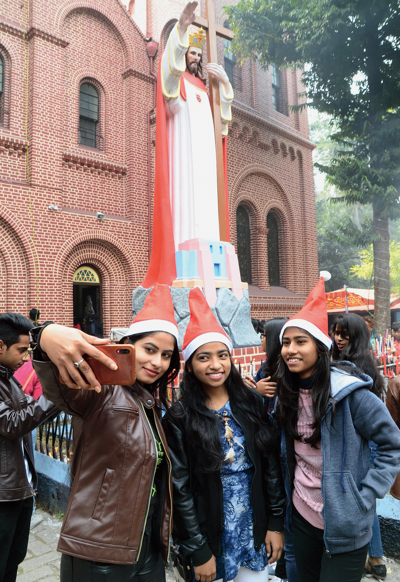 Girls click a groupfie outside St Mary's Cathedral in Ranchi on Wednesday.