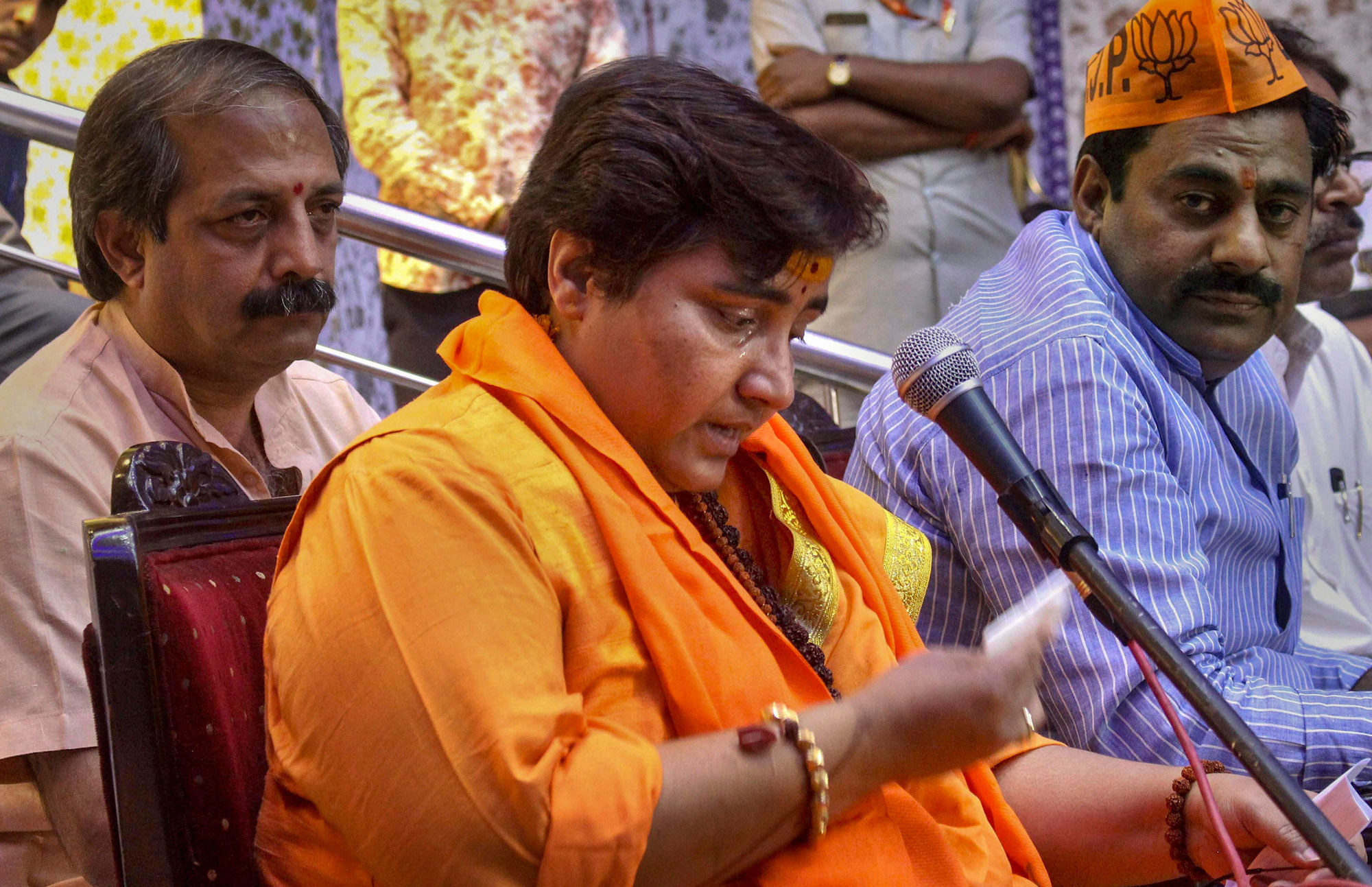 BJP candidate Sadhvi Pragya Singh Thakur reacts while addressing a party workers' meeting for Lok Sabha polls, in Bhopal on Thursday, April 18, 2019.